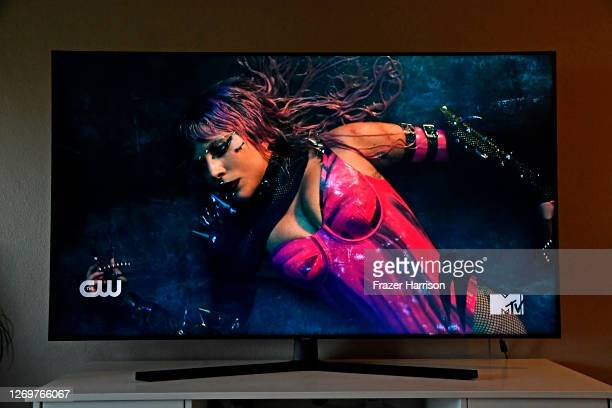 In this photo illustration Lady Gaga viewed on a television screen performs during the 2020 MTV Video Music Awards broadcast on August 30 2020