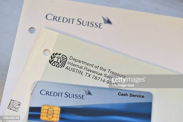 In this photo illustration letterhead details of the Internal Revenue Service and the Credit Suisse are displayed on February 24 2011 in Basel...