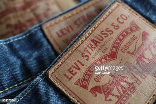 In this photo illustration Levi's 501 blue jeans by US clothing manufacturer Levi Strauss are seen on March 8 2018 in Berlin Germany US President...