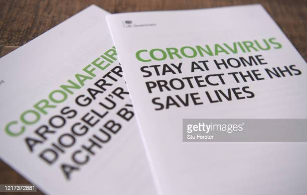 In this photo illustration Literature written in both English and Welsh is seen on Goverment Coronavirus advice leaflets sent to households from...