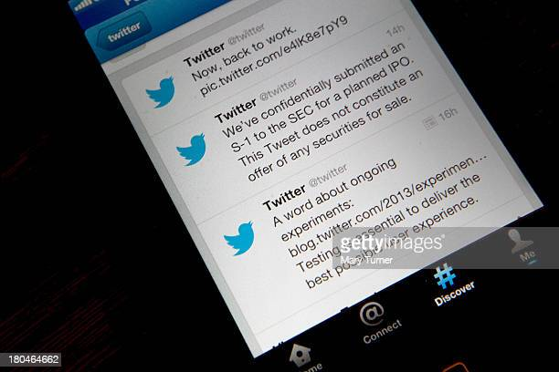 In this photo illustration logos for the microblogging site Twitter displayed on the internet on a mobile telephone on September 13 2013 in London...