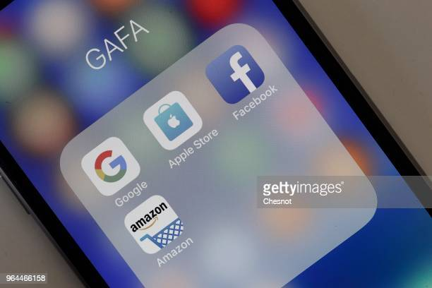In this photo illustration logos of the Google Apple Facebook and Amazon applications are displayed on the screen of an Apple iPhone on May 31 2018...