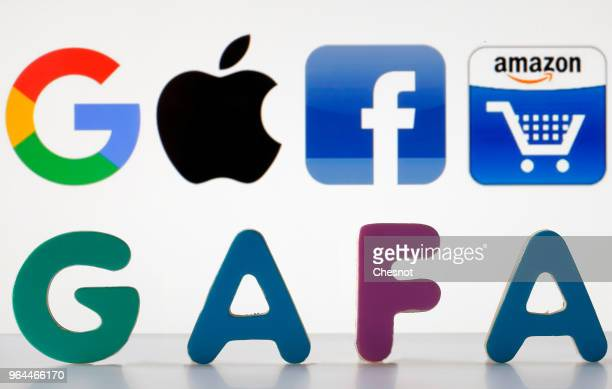 In this photo illustration logos of the Google Apple Facebook and Amazon are displayed on the screen of a computer on May 31 2018 in Paris France The...