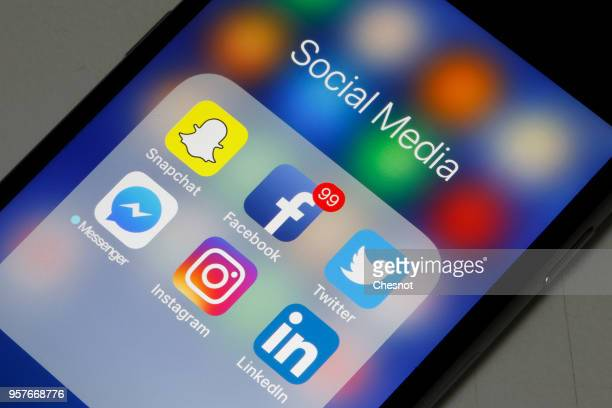 In this photo illustration logos of the Snapchat Facebook Twitter Messenger Instagram and LinkedIn applications are displayed on the screen of an...