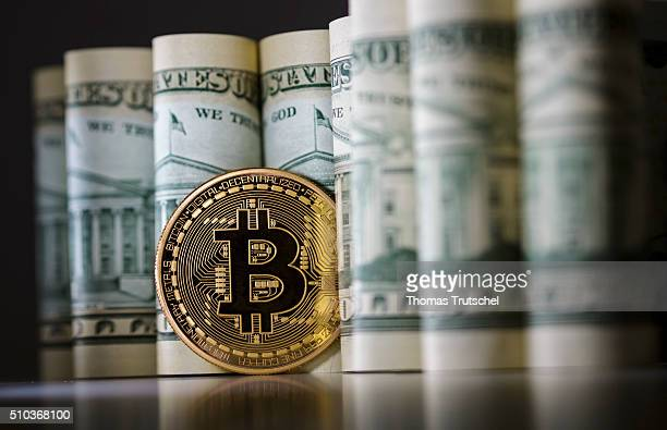 In this photo illustration model Bitcoins standing in front of Dollar bills on February 15 2016 in Berlin Germany