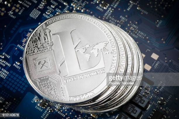 In this photo illustration model coins of the cryptocurrency Litecoin lie on a circuit board of a computer on January 25 2018 in Berlin Germany