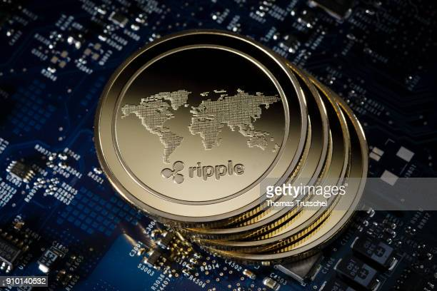 In this photo illustration model coins of the cryptocurrency Ripple lie on a circuit board of a computer on January 25, 2018 in Berlin, Germany.