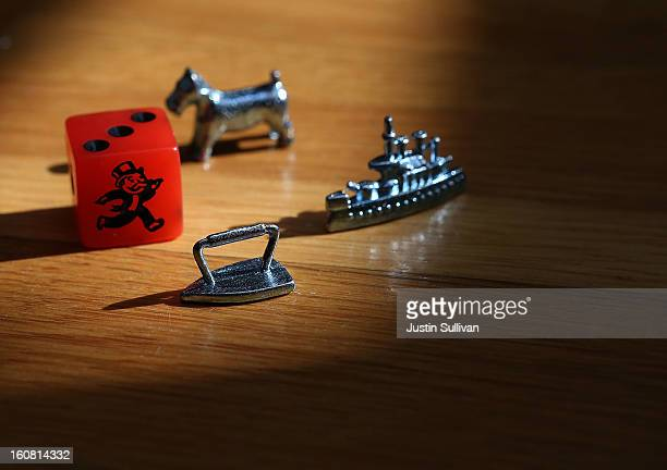 In this photo illustration, Monopoly board game pieces are displayed on February 6, 2013 in Fairfax, California. Toy maker Hasbro, Inc. Announced...