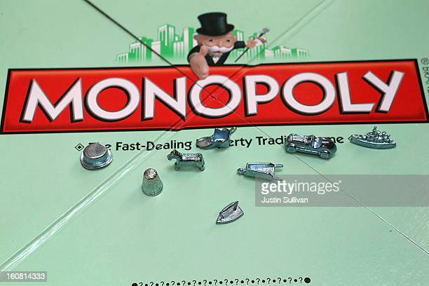 In this photo illustration Monopoly game pieces are displayed on February 6 2013 in Fairfax California Toy maker Hasbro Inc announced today that fans...