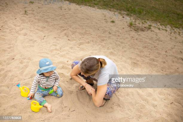 In this photo illustration mother and child are playing on a playground on July 24, 2020 in Bonn, Germany.