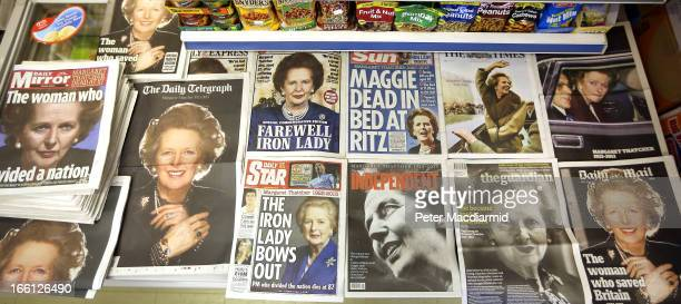 In this photo illustration newspapers are laid out in a news agent shop the day after the death of former Prime Minister Lady Thatcher on April 9...