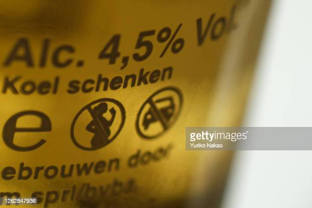 """In this photo illustration, """"no alcohol when pregnant"""" and """"don't drink and drive"""" warning logos are pictured on a beer bottle on July 20, 2020 in..."""