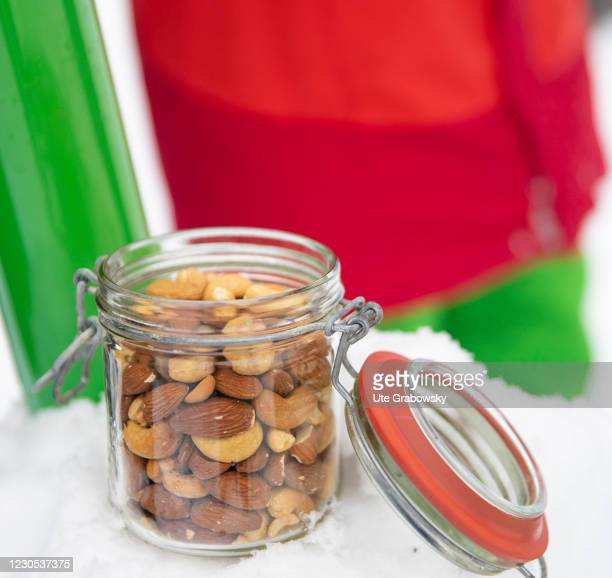 In this photo illustration Nuts and almonds are offerts in a glass on January 09, 2021 in Bonn, Germany.