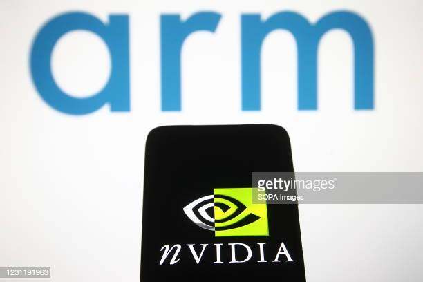 In this photo illustration, Nvidia logo is seen displayed on a smartphone screen in front of ARM logo.