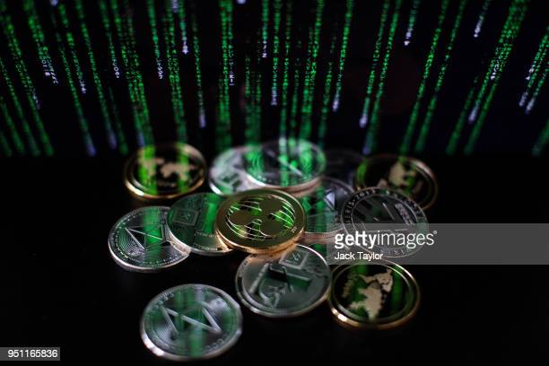In this photo illustration of the litecoin ripple and ethereum cryptocurrency 'altcoins' sit arranged for a photograph on April 25 2018 in London...