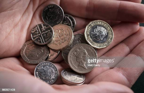 In this photo illustration old £1 coins are seen among handful of other change on October 13 2017 in Bristol England The deadline to use the old one...
