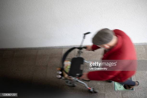 In this photo illustration on old man is running with his rolator on January 23, 2021 in Heidelberg, Germany.