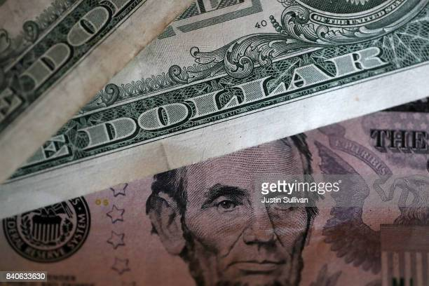 In this Photo Illustration One and five dollar bills are displayed on August 29 2017 in San Anselmo California The dollar fell to a two and a half...