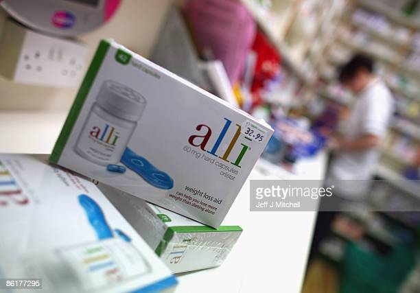 In this photo illustration, packets of the Alli slimming pill are displayed for sale at G W Allan chemists on April 23, 2009 in Edinburgh, Scotland....