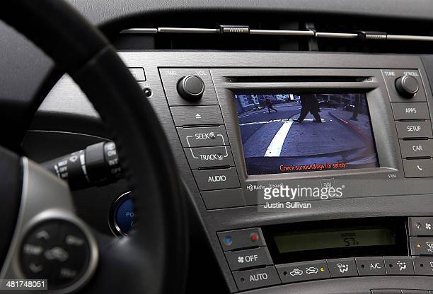 In this photo illustration pedestrians are displayed on the video display of a backup camera on a Toyota Prius on March 31 2014 in San Francisco...