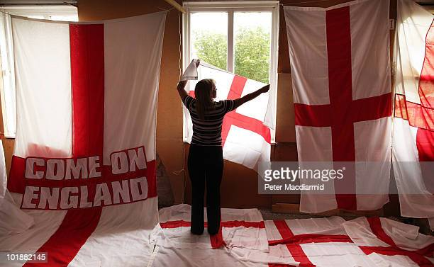 In this photo illustration Piggotts' employee Kelly Seymour checks a flag of St George in the warehouse of the flag maker on June 8 2010 in Ongar...