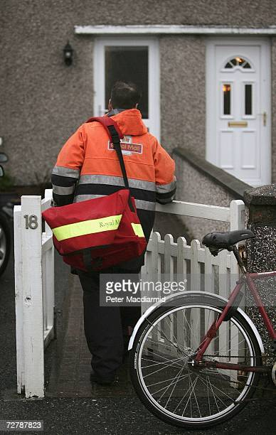 In this photo illustration postman Leslie Guy delivers letters to a local address in Stornoway on the island of Lewis Scotland on November 30 2006...