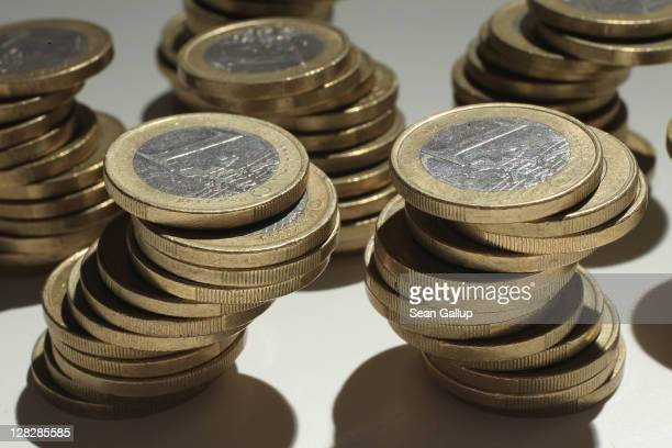 In this photo illustration precarious towers of one Euro coins stand on October 6 2011 in Berlin Germany World finance leaders are scheduled to meet...