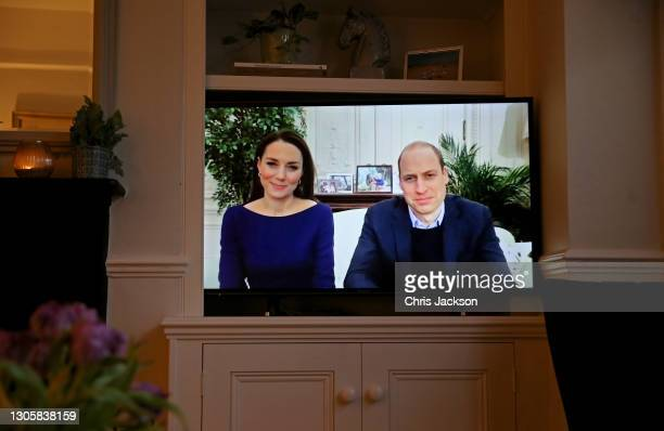 In this photo illustration, Prince William, Duke of Cambridge and Catherine, Duchess of Cambridge take part in a Commonwealth Day broadcast on the...