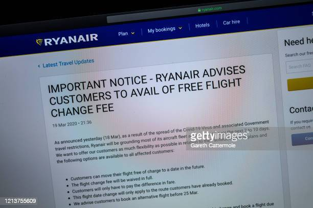 In this photo illustration Ryanair advises customers of its current flight status on March 19 2020 in Essex England Many highstreet shops have had to...