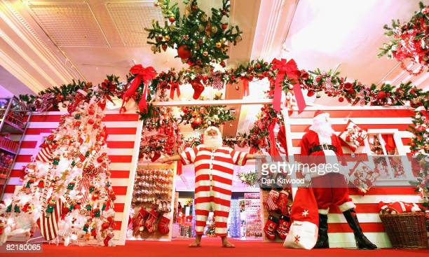In this photo illustration Santa Claus stands in the new Christmas section at Harrods Department Store on August 05 2008 in London England