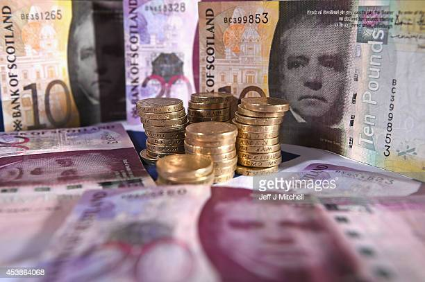 In this photo illustration, Scottish Bank notes are placed on a table on August 20, 2014 in Glasgow,Scotland. First Minister Alex Salmons, chief...