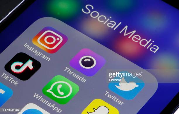 In this photo illustration social media Instagram Threads Twitter TikTok WhatsApp and Snapchat application logos are displayed on the screen of a...