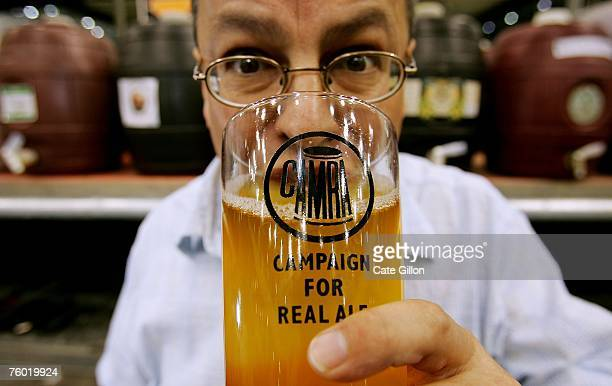 In this photo illustration, Steve Williams, Regional Director for Greater London of CAMRA enjoys a pint of cider at the Beer Festival in Earls Court...