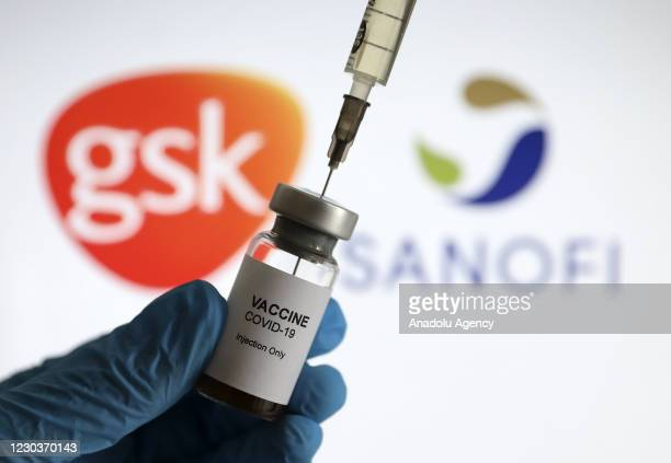 In this photo illustration taken in Ankara, Turkey on December 31 a vaccine syringe and a flacon are seen in front of a computer screen showing GSK...
