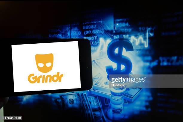 In this photo illustration taken in New York US on 15 October 2019 show the logo of the gay dating app Grindr is seen on a screen next to an...