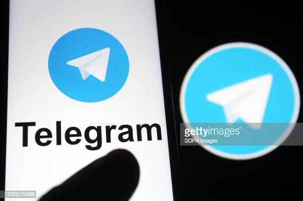 In this photo illustration, Telegram logo is seen displayed on a mobile phone screen in front of the logo. In the first week of January 2021,...