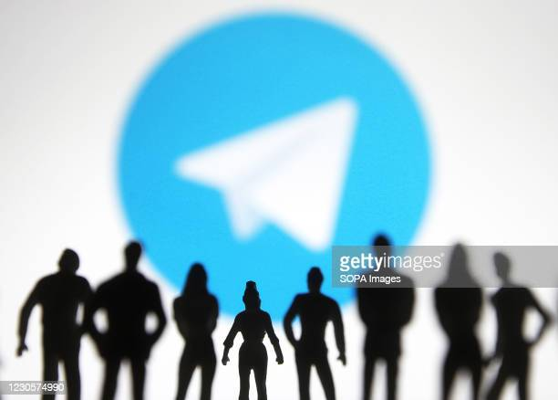 In this photo illustration, Telegram logo is seen on a screen in front of the silhouettes of toy people. In the first week of January 2021, Telegram...