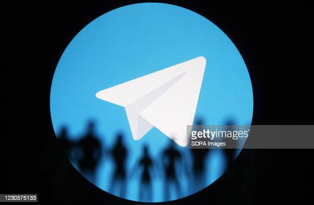 In this photo illustration, Telegram logo is seen on a screen in front of silhouettes of toy people. In the first week of January 2021, Telegram...