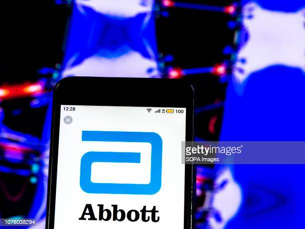 In this photo illustration the Abbott Laboratories Pharmaceutical company logo seen displayed on a smartphone