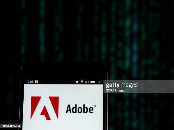 In this photo illustration the Adobe Inc logo seen displayed on a smartphone Adobe Inc is an American multinational computer software company