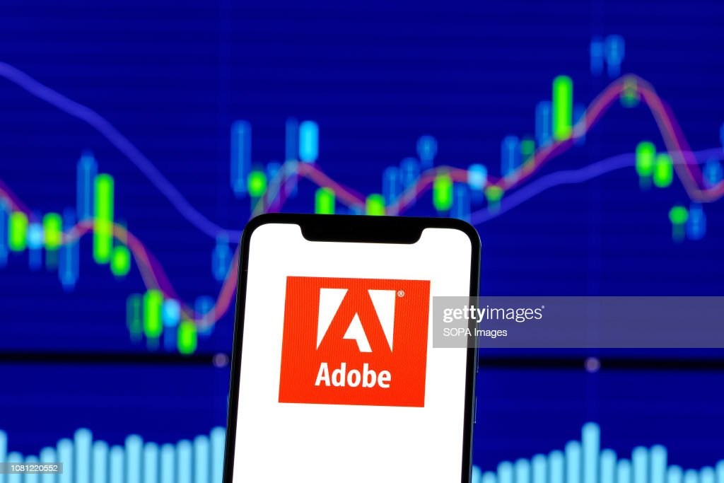 Adobe logo is seen on an android mobile phone over stock : News Photo
