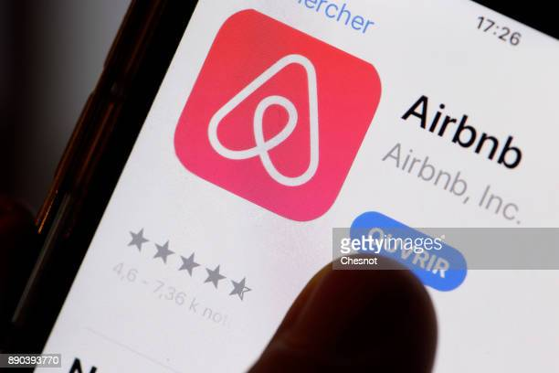 In this photo illustration the Airbnb app is displayed on the screen of an Apple iPhone 6 on December 11 2017 in Paris France Paris City Hall has...