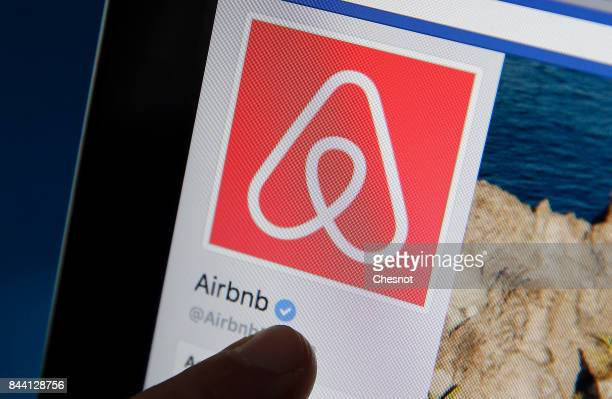 In this photo illustration the Airbnb company logo is displayed on the screen of an Apple iPhone 6 on September 08 2017 in Paris France The City of...