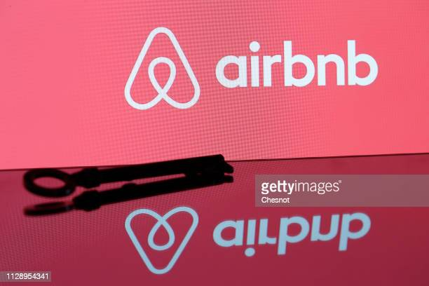 In this photo illustration the Airbnb logo is displayed on February 11 2019 in Paris France Paris is one of the most popular destinations for Airbnb...