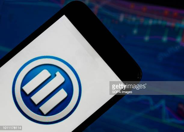 The Allianz SE application seen displayed on a smart phone with a background of a stock market shedle Allianz SE is a European financial services...