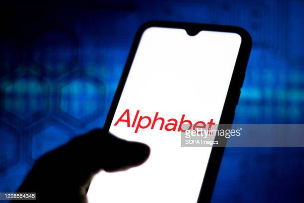 In this photo illustration the Alphabet logo seen displayed on a smartphone.