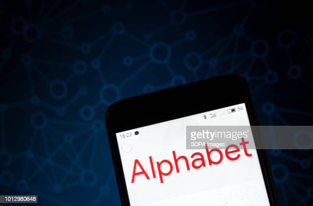 The Alphabet logo seen displayed on a smart phone According to the New York Stock Exchange the Alphabet is in third place at the market value in the...