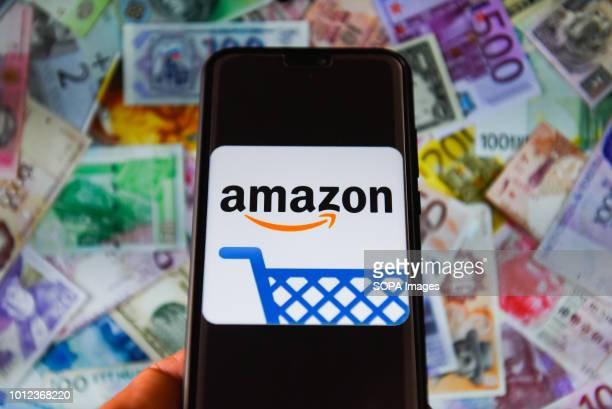 In this photo illustration the Amazon logo is seen displayed on a mobile phone