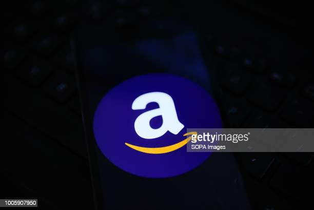 In this photo illustration the Amazon logo is seen displayed on an Android mobile device