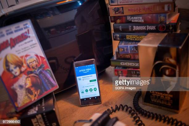 In this photo illustration the Amazon Prime Video application seen displayed on an Android Sony smartphone surrounded by old videotapes